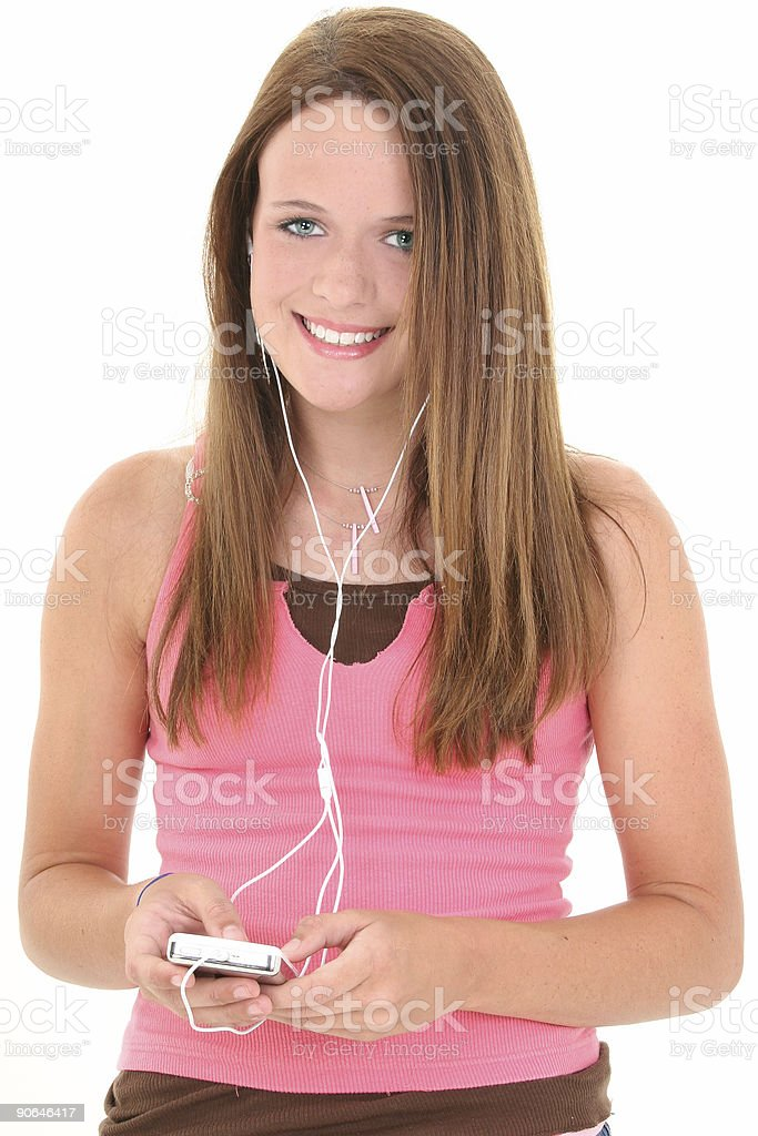 Beautiful Fourteen Year Old Teen Listening To Music stock photo