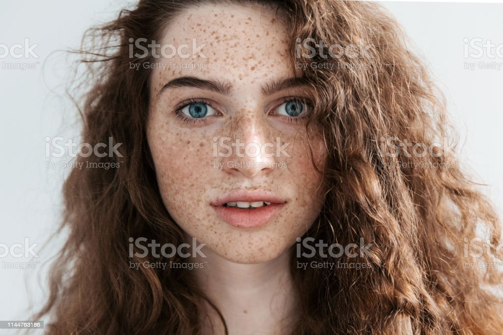 Beautiful Freckles Young Woman Close Up Portrait Attractive Model With Beautiful Blue Eyes And Ginger Curly Hair