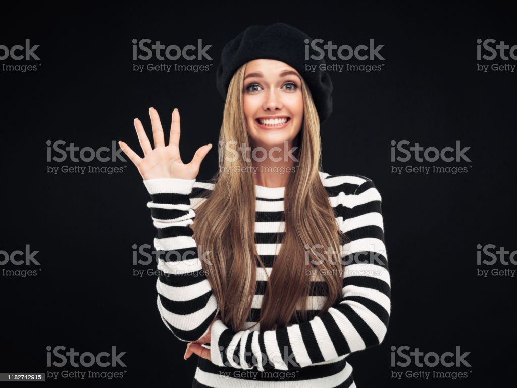 Beautiful french woman wearing black beret Beautiful french woman wearing black beret Adult Stock Photo