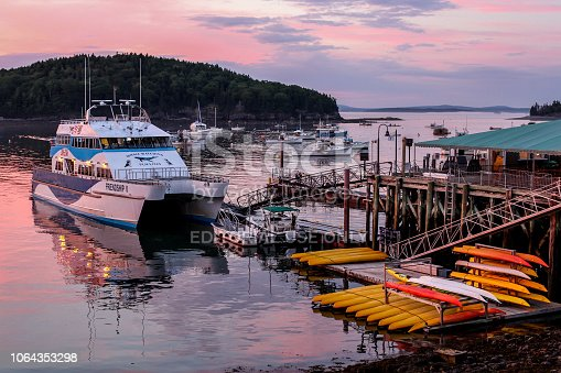 BAR HARBOUR, MAINE, USA - JULY 11, 2013: Beautiful Frenchman Bay sunset with docking boats in Bar Harbor,