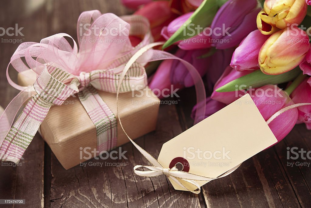 Beautiful fresh flower bouquet, gift box and an empty label royalty-free stock photo