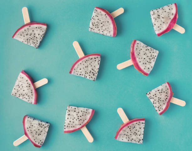 beautiful fresh sliced popsicles dragon fruit like background, Pitaya, flat lay on blue background, instagram style beautiful fresh sliced popsicles dragon fruit like background, Pitaya, flat lay on blue background, instagram style pitaya stock pictures, royalty-free photos & images