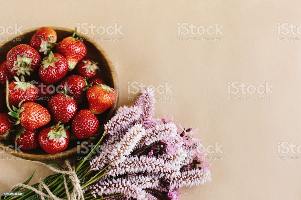 Beautiful fresh strawberries and pink flowers on craft background beautiful fresh strawberries and pink flowers on craft background summer concept space for your mightylinksfo