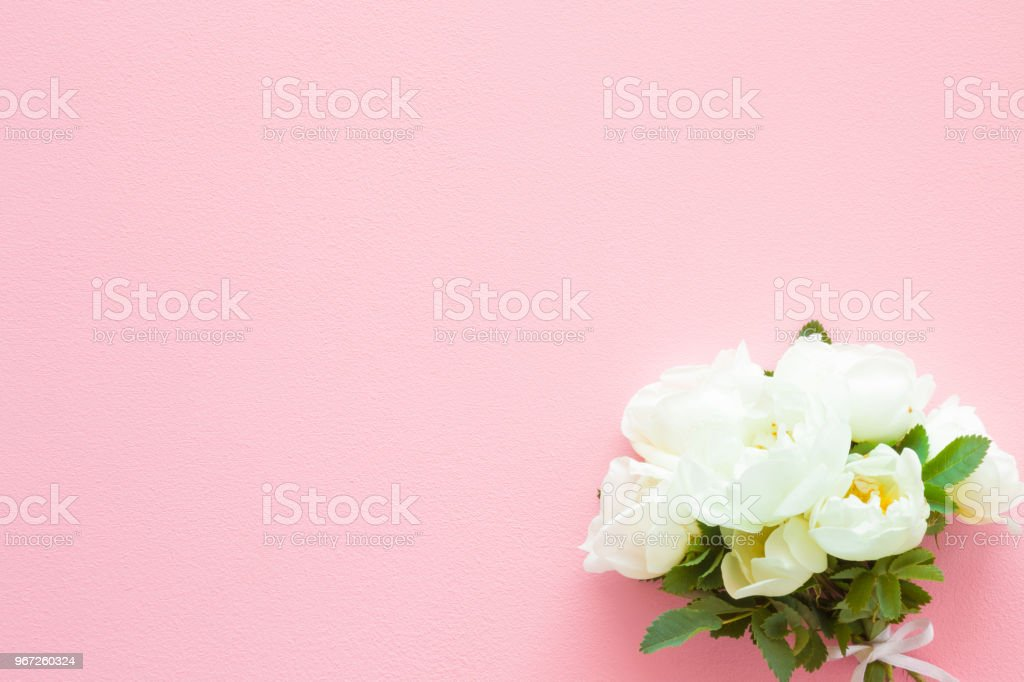 Beautiful fresh wedding bouquet of white roses on pastel pink table beautiful fresh wedding bouquet of white roses on pastel pink table soft light color m4hsunfo