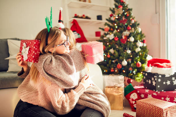 Beautiful friends/sisters enjoying Christmas eve/New year. stock photo