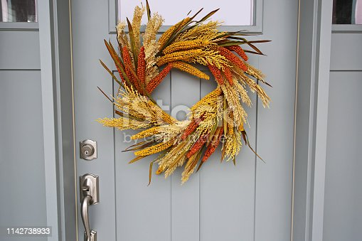 istock Beautiful Front Door Autumn Wreath Close Up 1142738933