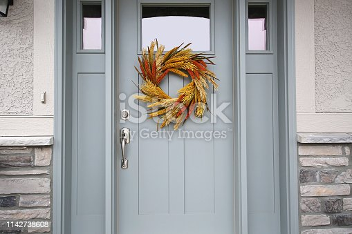 istock Beautiful Front Door Autumn Wreath 1142738608