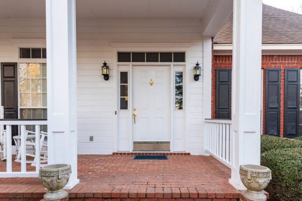 Beautiful front door to suburban home Front door and porch of a residential home front door stock pictures, royalty-free photos & images