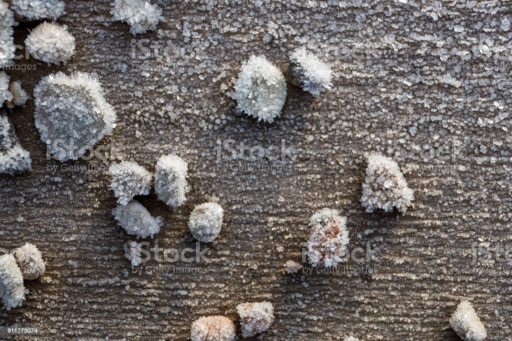 Beautiful frost crystals on wood close-up texture background royalty-free stock photo