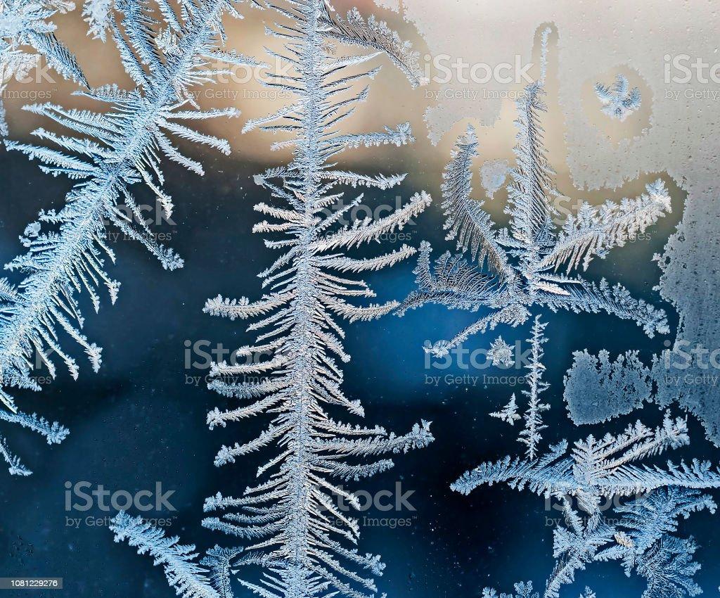beautiful frosty patterns on glass stock photo