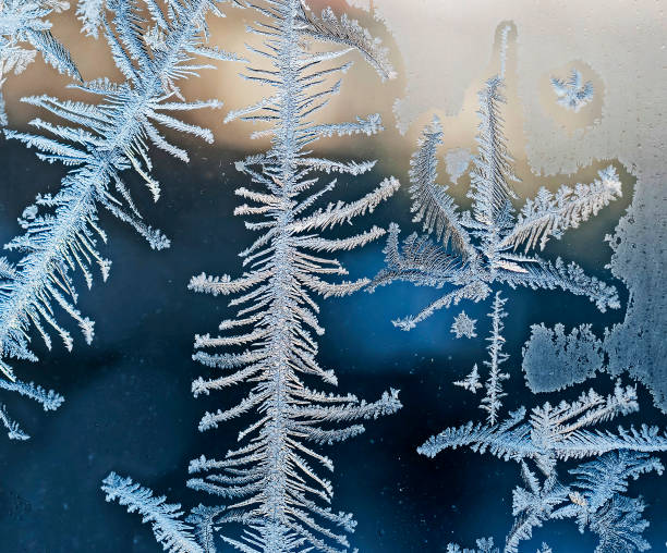 beautiful frosty patterns on glass stock photo
