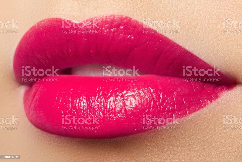 Beautiful full pink lips. Pink lipstick. Make-up and cosmetics - foto de acervo