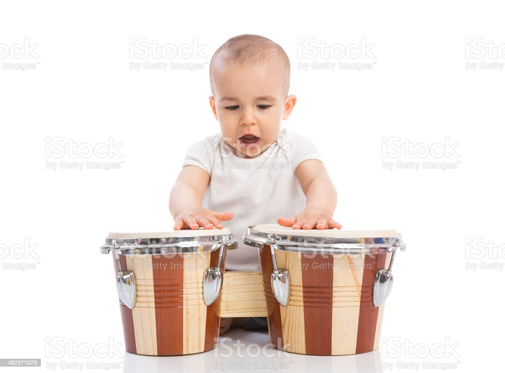 Beautiful funny baby child playing drums and singing stock photo