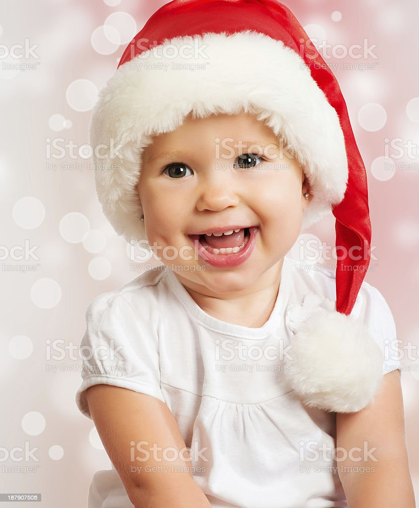 78903396d09 Beautiful Funny Baby In A Christmas Hat On Pink Stock Photo   More ...
