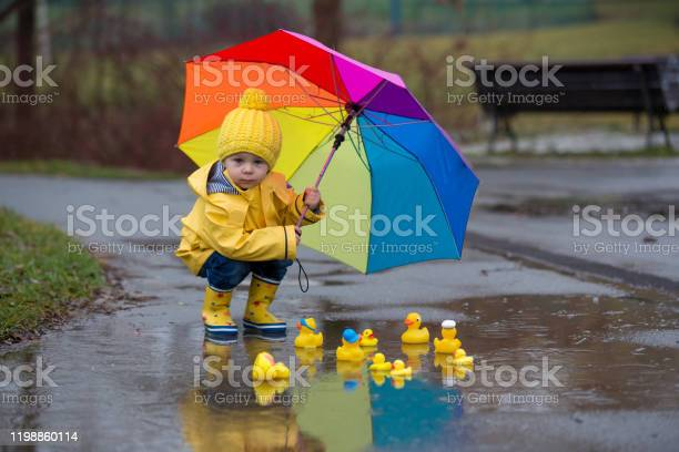 Beautiful funny blonde toddler boy with rubber ducks and colorful picture id1198860114?b=1&k=6&m=1198860114&s=612x612&h=uylzp5bxlbqh frq6iwbpoudd00olsr1jdf5emq d2g=