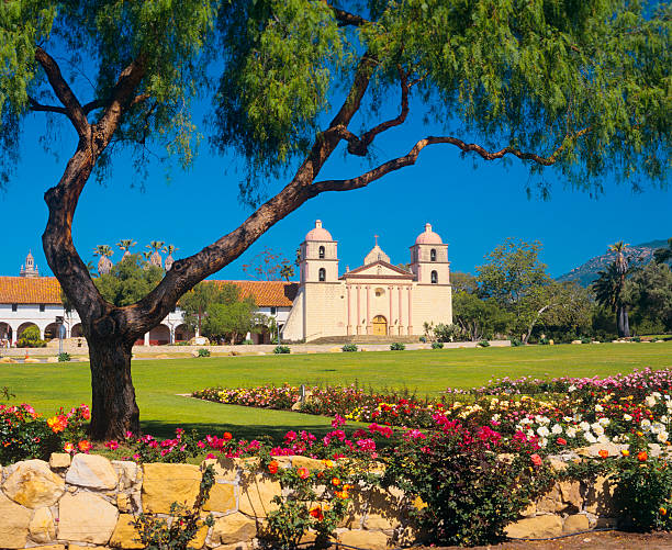 Beautiful garden at Santa Barbara Mission A rose garden grows in front of the Santa Barbara Mission. santa barbara california stock pictures, royalty-free photos & images