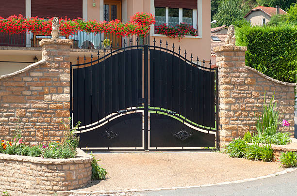 Beautiful gate, entrance to a front yard stock photo