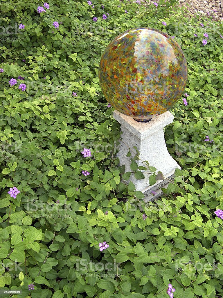 beautiful gazing ball in lush lantana royalty-free stock photo