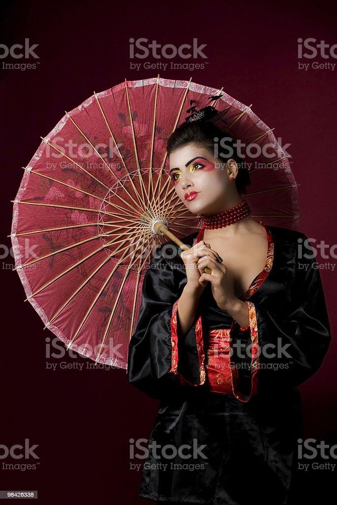 beautiful geisha looking sideways royalty-free stock photo