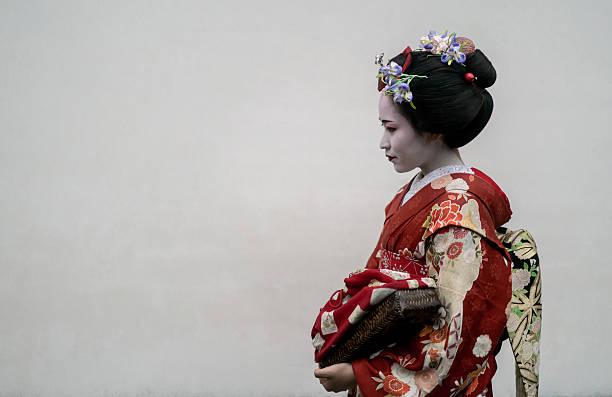 Beautiful Geisha wearing a kimono Portrait of a beautiful Geisha wearing a kimono - Japanese culture geisha stock pictures, royalty-free photos & images