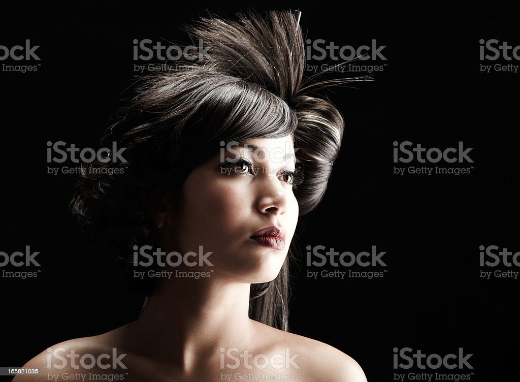 Beautiful geisha with dramatic hairstyle on black background stock photo