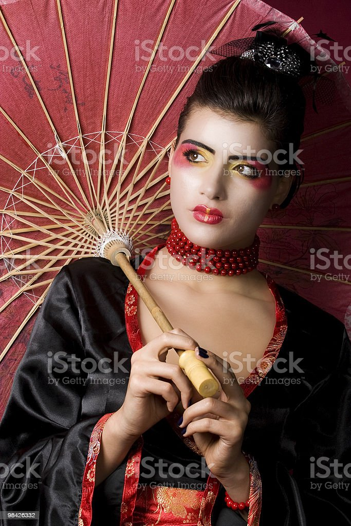 Beautiful geisha with painted umbrella royalty-free stock photo