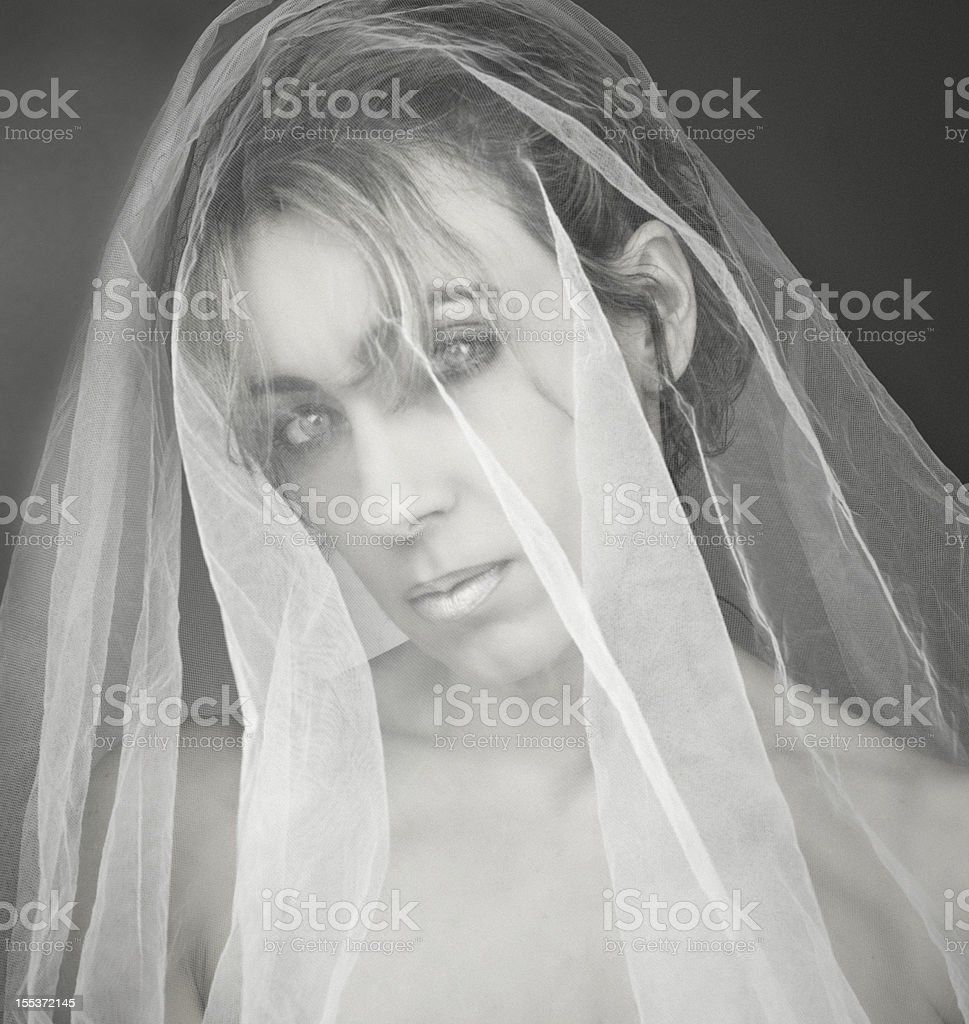 Beautiful Ghostly Woman Behind Veil royalty-free stock photo