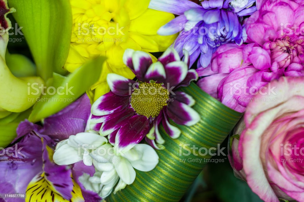 Beautiful gift bouquet of various colorful decorative summer flowers,...