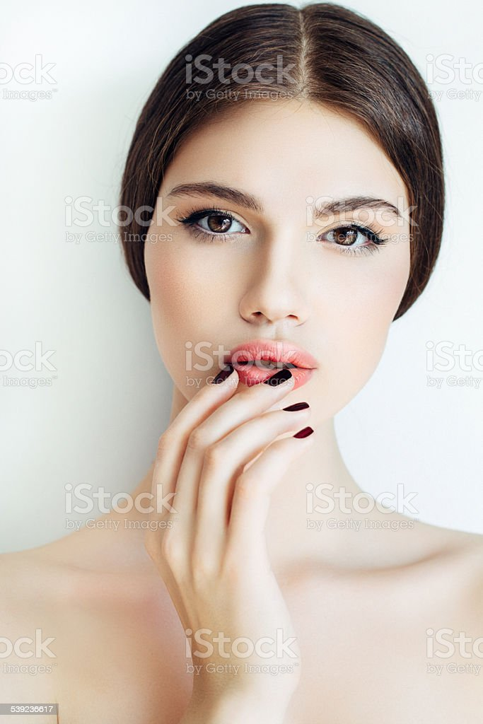 Beautiful girl against the wall royalty-free stock photo