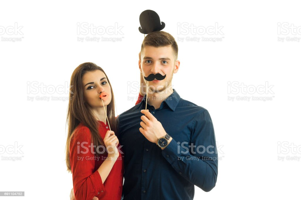 beautiful girl and a guy are looking into the camera and hold near persons transfer paper for photo stock photo