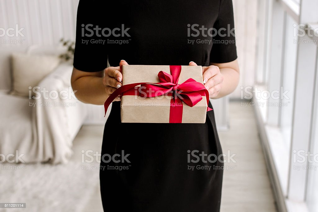 beautiful girl and gift stock photo