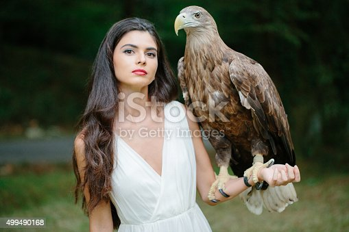 Beautiful girl and her eagle