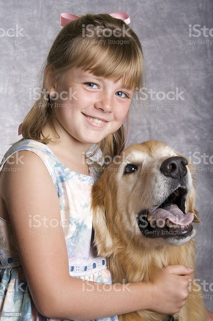 Beautiful Girl and her Golden Retriever royalty-free stock photo