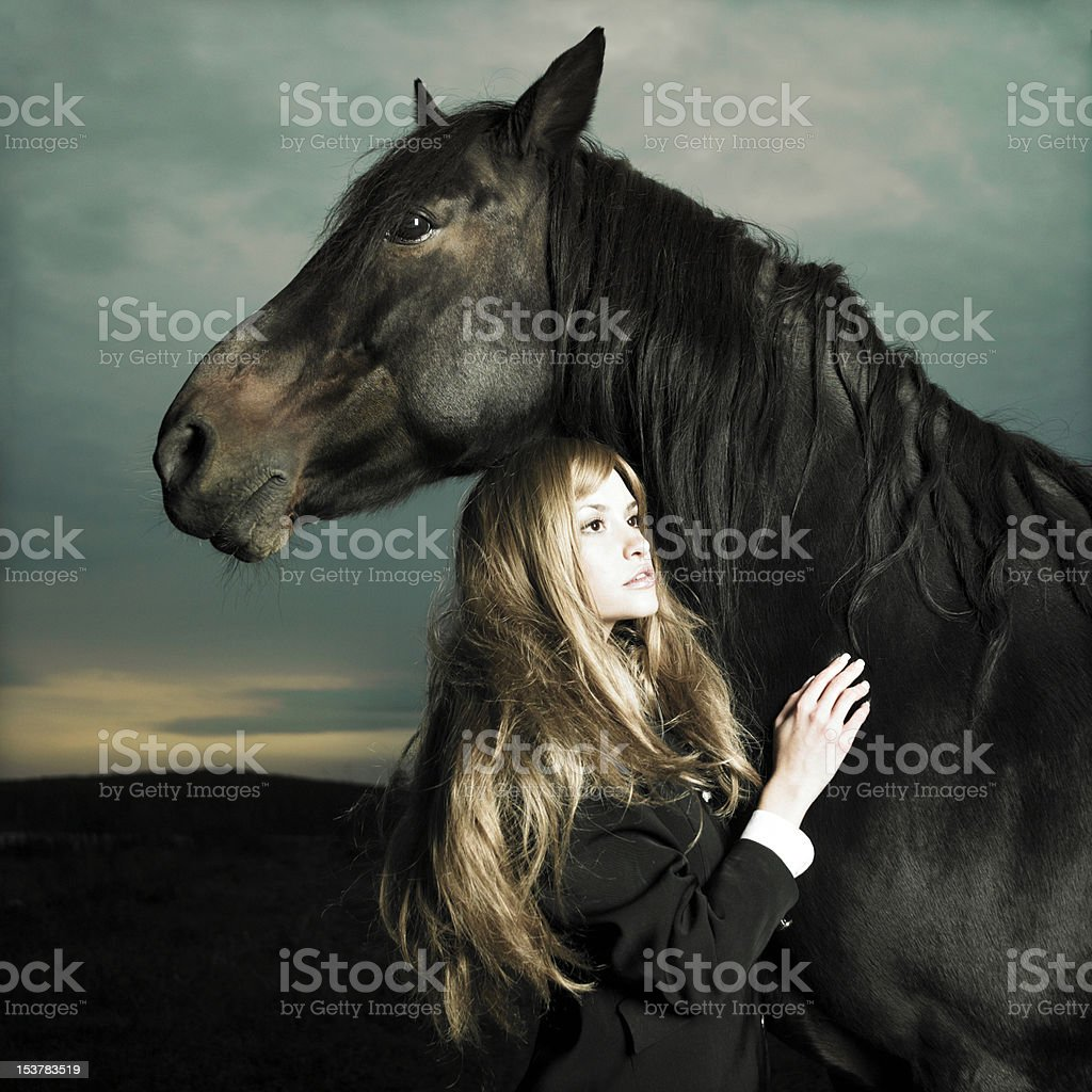 Beautiful girl and horse royalty-free stock photo