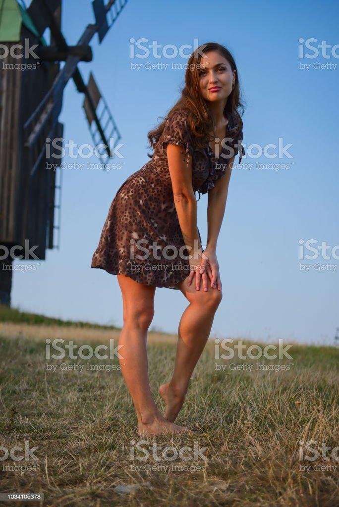 Beautiful girl and windmill stock photo