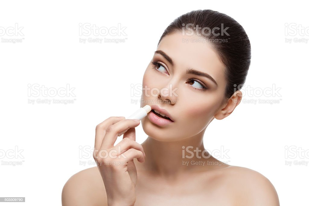 Beautiful girl applying chapstick stock photo