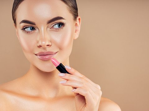 Beautiful girl applying make-up