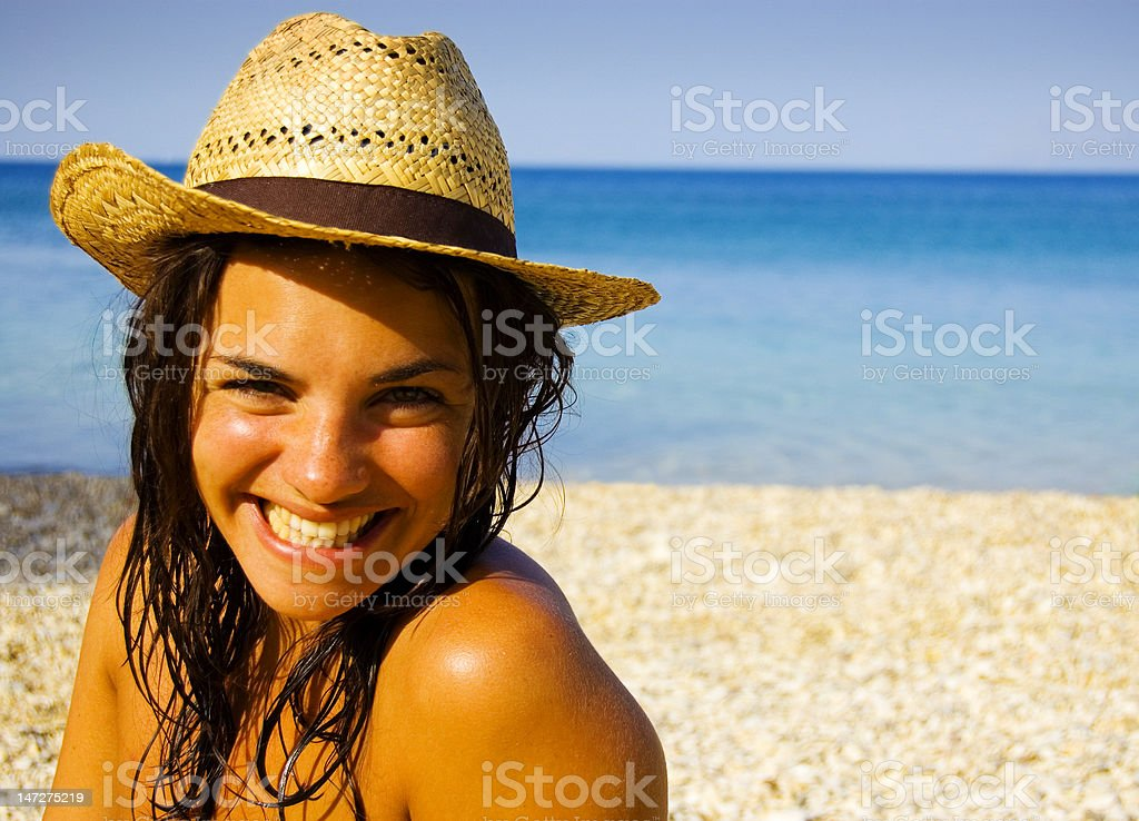 Beautiful girl at the beach on a hot summer's day royalty-free stock photo