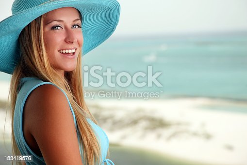 istock Beautiful Girl at the Beach Smiling 183419576