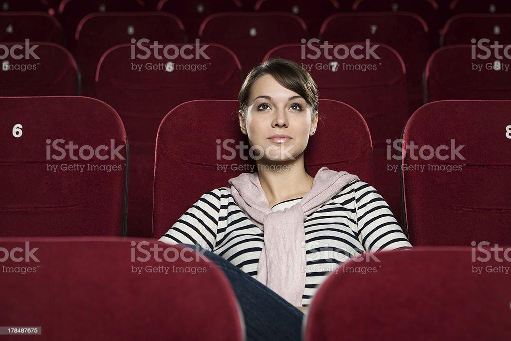 Beautiful girl at the cinema royalty-free stock photo