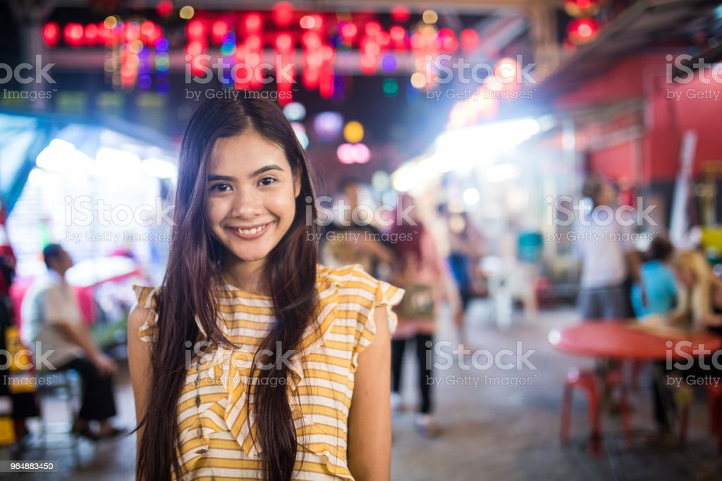 Beautiful girl at the Jalan Petaling market royalty-free stock photo