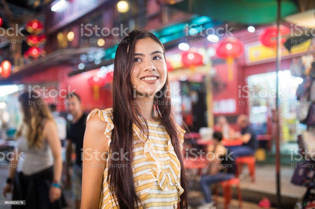 Beautiful girl at the Jalan Petaling market royalty-free stock photo