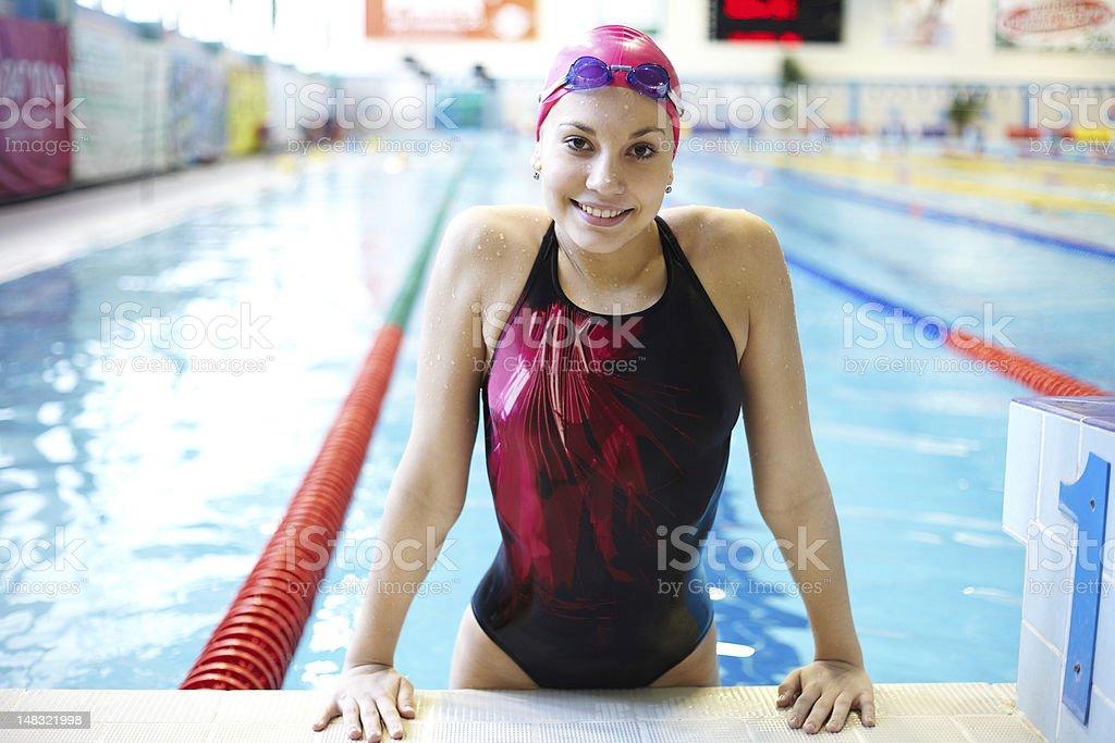 beautiful girl  at the pool stock photo