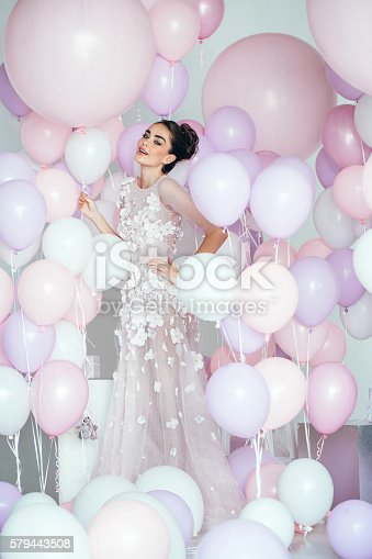 579443552istockphoto Beautiful girl at the studio with balloons 579443508