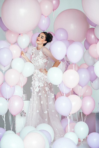 579443552 istock photo Beautiful girl at the studio with balloons 579443508