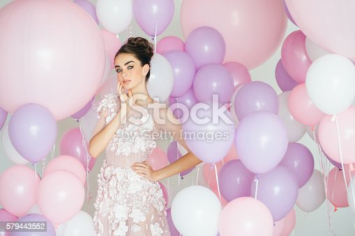 istock Beautiful girl at the studio with balloons 579443552