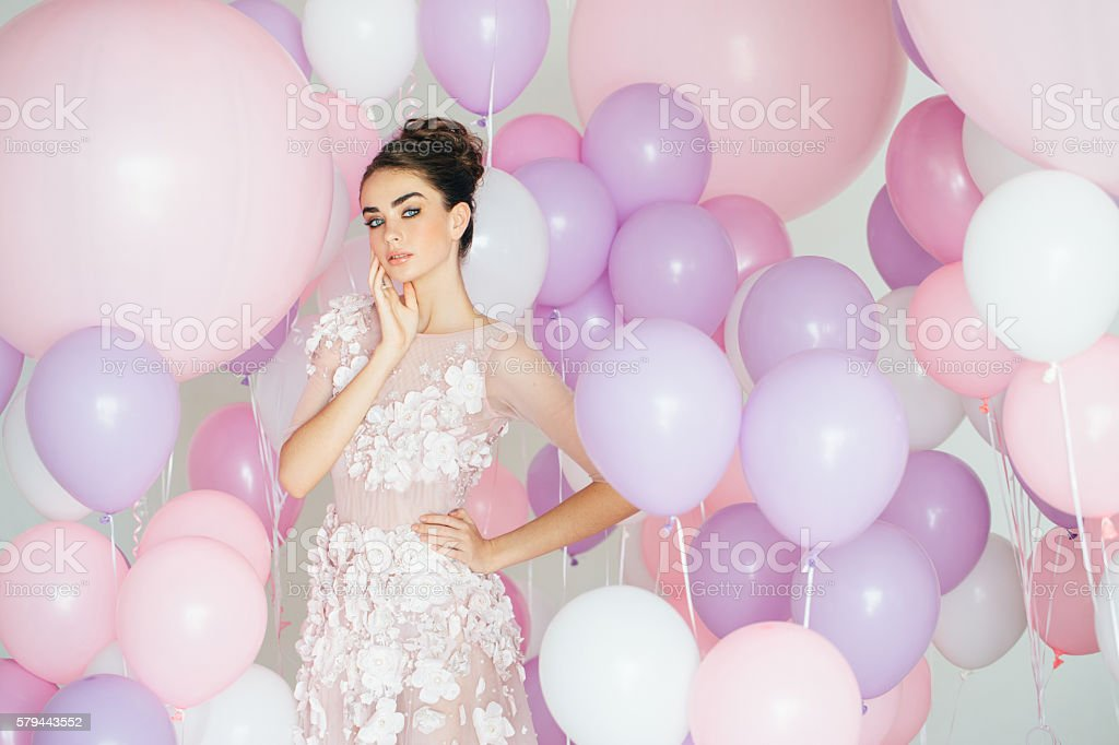 Beautiful girl at the studio with balloons stok fotoğrafı