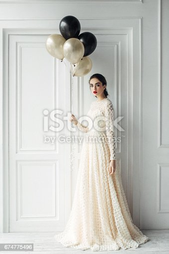 istock Beautiful girl at the studio with balloons 674775496