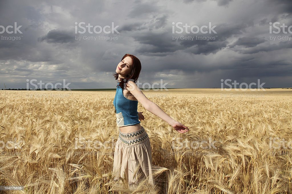 beautiful girl at wheat field in rainy day royalty-free stock photo