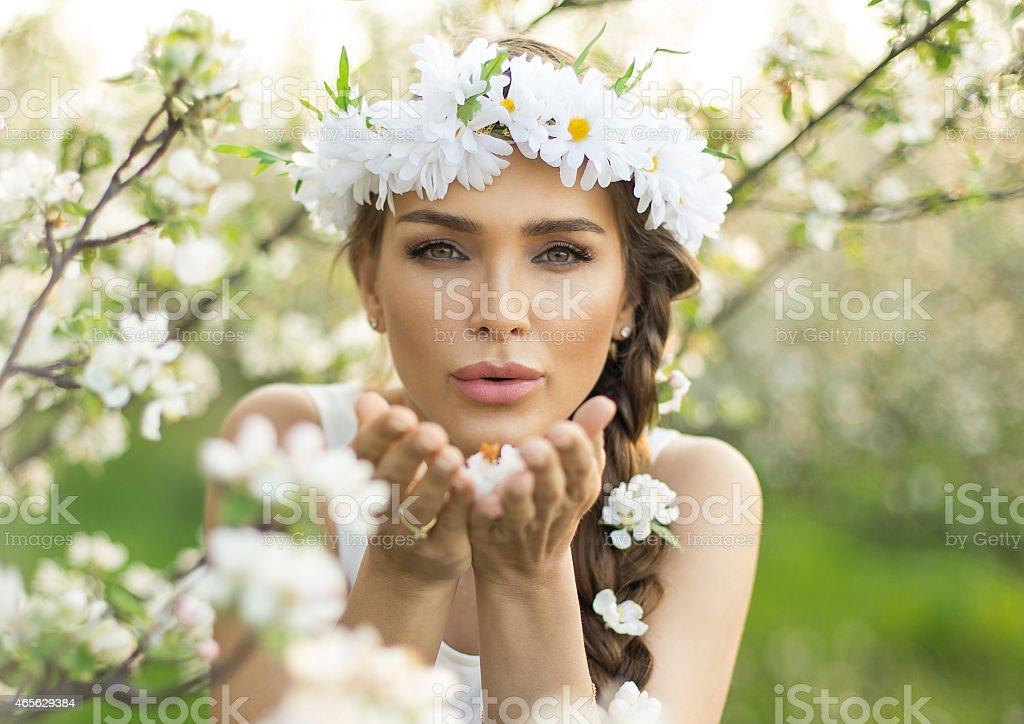 Beautiful girl blowing stock photo